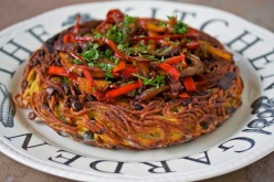 Saffron noodle cake with sauteed peppers