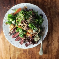 Steak salad with roasted shallot and garlic dressing